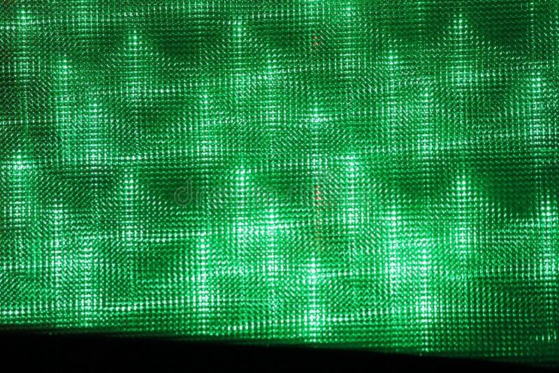 El parque de atracciones del fondo enciende verde imágenes de archivo libres de regalías