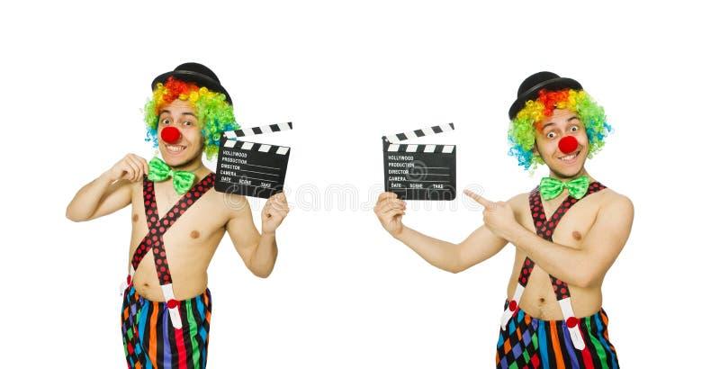 El payaso con el tablero de la película en blanco fotografía de archivo