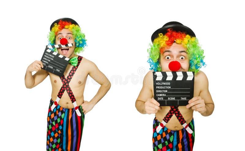 El payaso con el tablero de la película en blanco imagenes de archivo