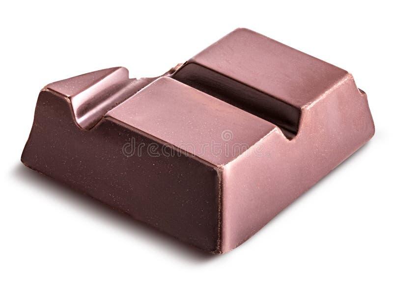El pedazo de chocolate negro se aísla en un fondo blanco fotos de archivo libres de regalías