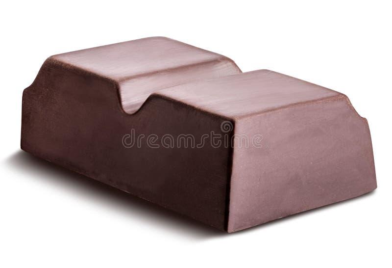 El pedazo de chocolate negro se aísla en un fondo blanco foto de archivo