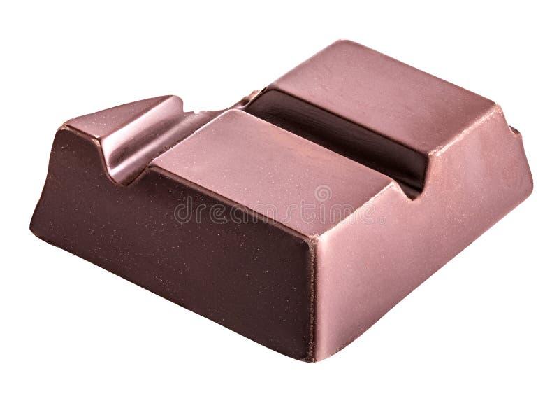 El pedazo de chocolate negro se aísla en un fondo blanco foto de archivo libre de regalías