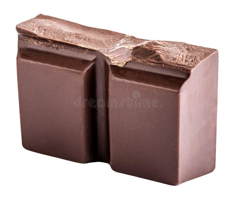 El pedazo de chocolate negro se aísla en un fondo blanco imagen de archivo libre de regalías