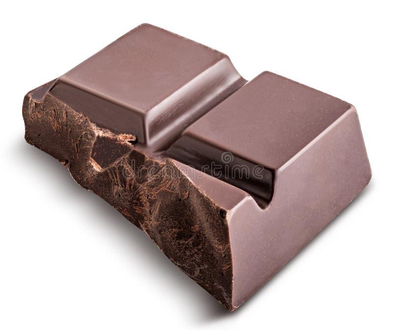 El pedazo de chocolate negro se aísla en un fondo blanco fotografía de archivo libre de regalías