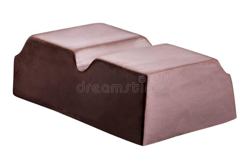 El pedazo de chocolate negro se aísla en un fondo blanco imagen de archivo