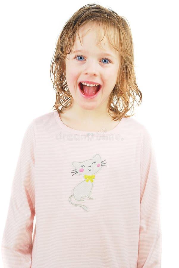 El pequeño desgastar rubio de la muchacha pijamas imagenes de archivo