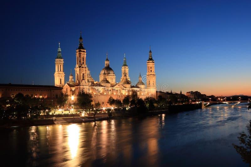 El Pilar Basilica (Zaragoza, Spain). El Pilar basilica by the Ebro River. Night scene. (Zaragoza, Spain stock image