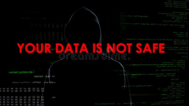 El pirata informático anónimo amenaza a la seguridad del mundo, datos confidenciales sin la protección fotos de archivo
