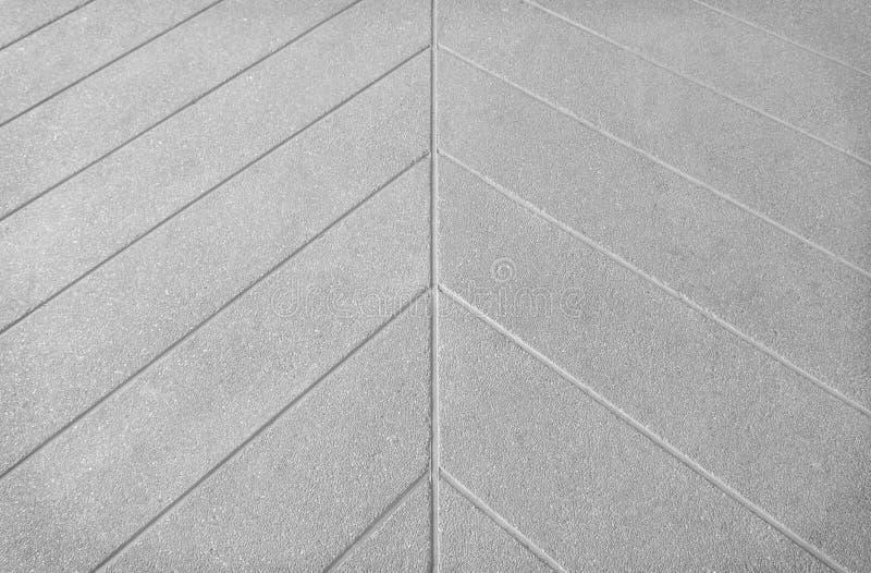 El piso concreto gris en línea imprimió textura de los modelos en fondo imagen de archivo libre de regalías