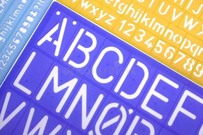 El plástico inglés de las letras estarce alfabeto fotografía de archivo libre de regalías