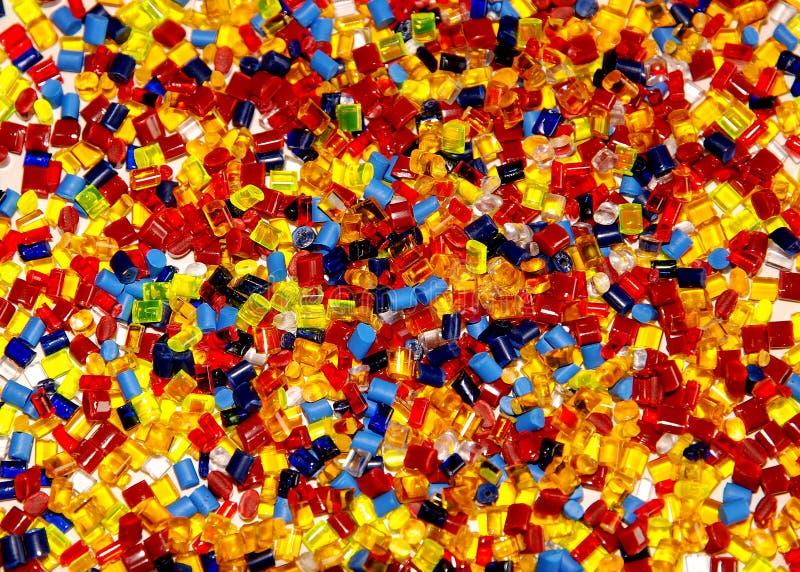 El plástico teñido granula foto de archivo libre de regalías