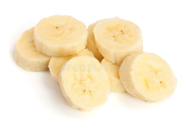 el plátano cortó aislado en el fondo blanco Visión superior Endecha plana fotos de archivo