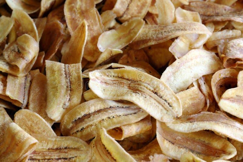 El plátano frió la rebanada de los pedazos ligeramente, textura del plátano frita, del fondo fondo frito plátano de los pedazos imagen de archivo libre de regalías