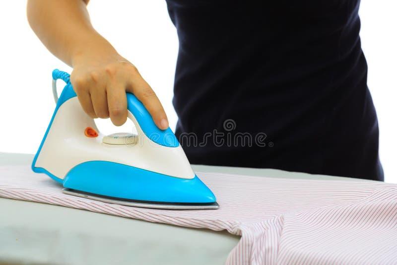 El planchar de la ropa fotografía de archivo
