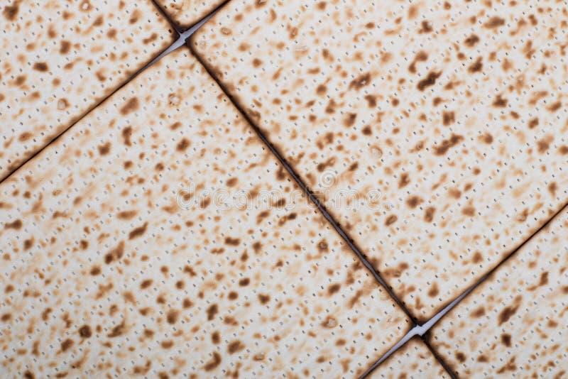 El plano de la textura del Matzah del fondo de la pascua judía pone el día de fiesta judío Nisan del pesach foto de archivo