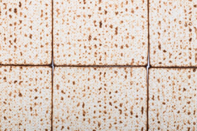 El plano de la textura del Matzah del fondo de la pascua judía pone el día de fiesta judío Nisan del pesach foto de archivo libre de regalías
