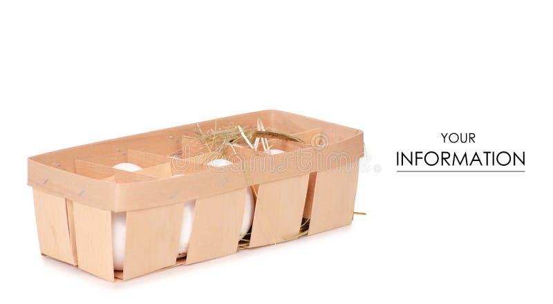 El pollo eggs en una caja de madera de modelo del heno imagenes de archivo