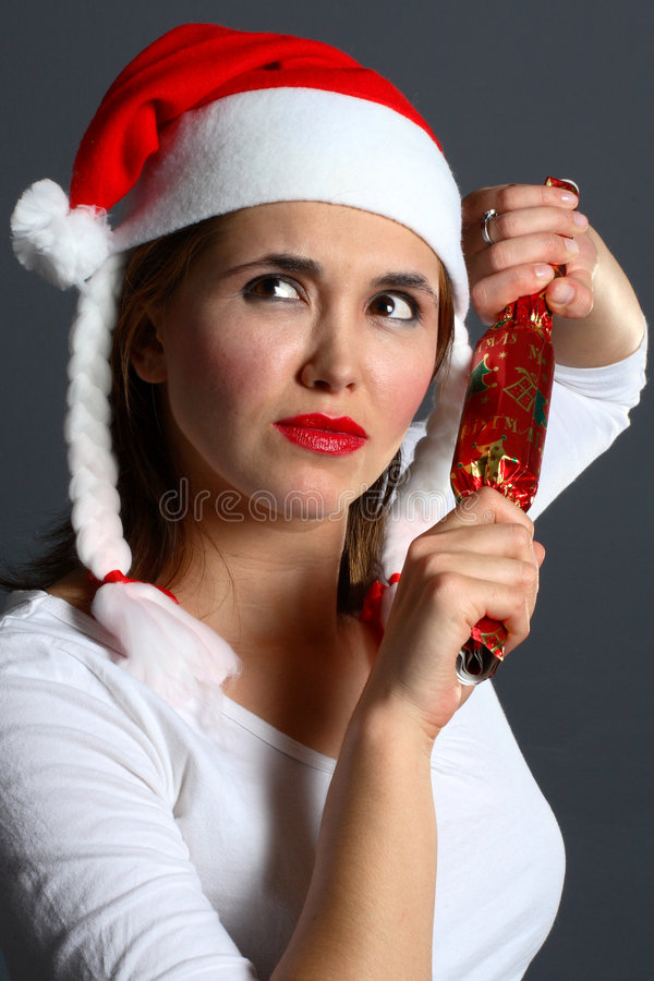 El preguntarse de la muchacha de Santa imagenes de archivo
