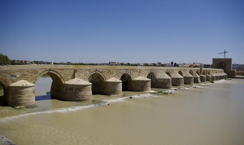 El Puente Remano over the Guadalquivir river in Cordova. The Roman bridge over the Guadalquivir river in Cordova, Spain royalty free stock image