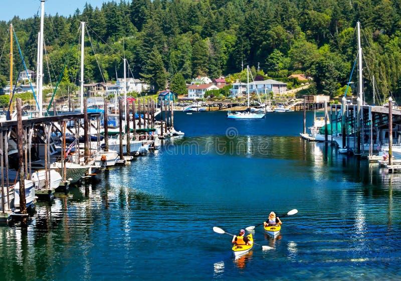 El puerto deportivo Kayaks puerto Washington del carruaje de la reflexión foto de archivo libre de regalías