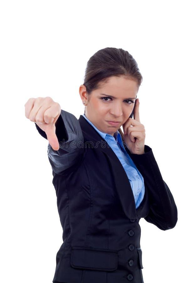 El pulgar abajo gesticula en el teléfono fotografía de archivo libre de regalías