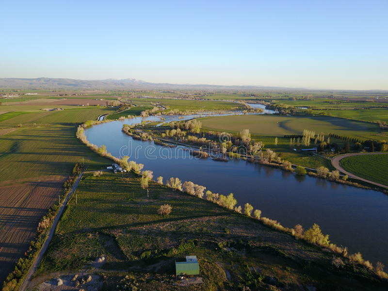 El río Snake a través de tierras de labrantío foto de archivo libre de regalías