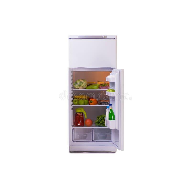 El refrigerador moderno aislado en el fondo blanco imagenes de archivo
