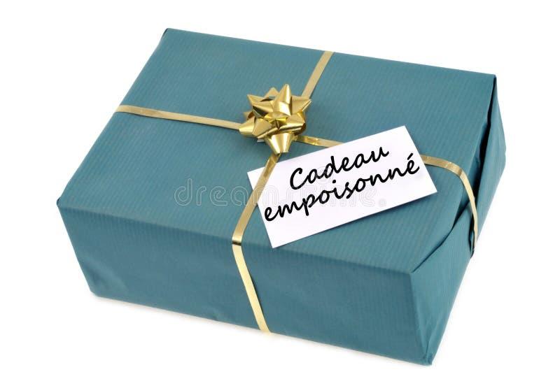 El regalo envenenado escrito en francés fotografía de archivo libre de regalías