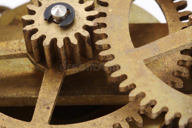 El reloj antiguo engrana macro imagenes de archivo