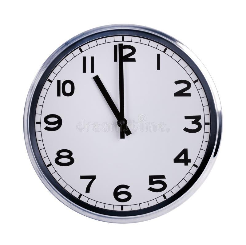 El reloj redondo de la oficina muestra las once fotografía de archivo libre de regalías