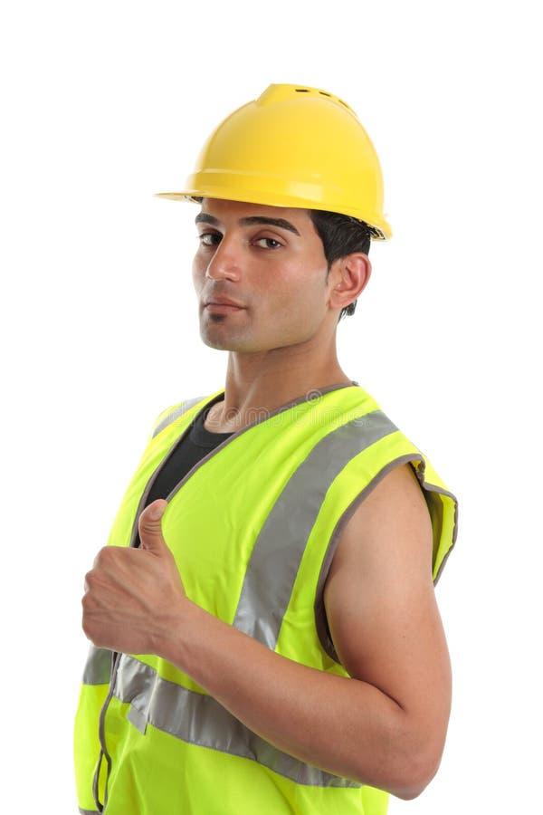 El reparador del constructor manosea con los dedos para arriba fotos de archivo libres de regalías