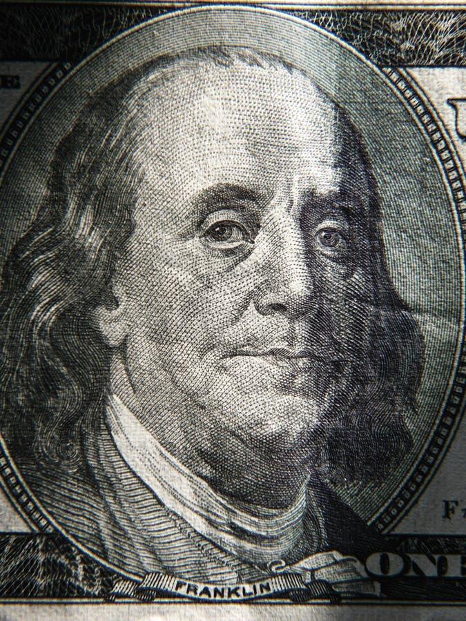 El retrato de Benjamin Franklin se representa en los billetes de banco de $ 100 fotos de archivo