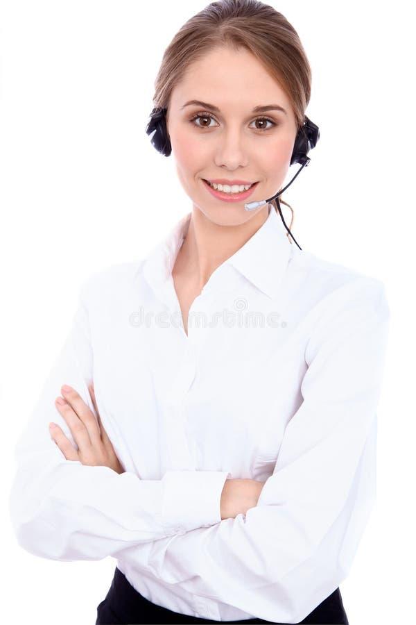 El retrato de jóvenes alegres sonrientes apoya al operador del teléfono en las auriculares, aisladas sobre el fondo blanco imagenes de archivo