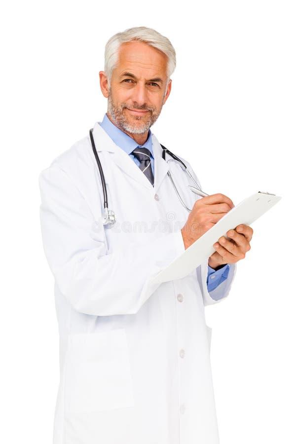 El retrato de una escritura masculina confiada del doctor divulga imagen de archivo libre de regalías