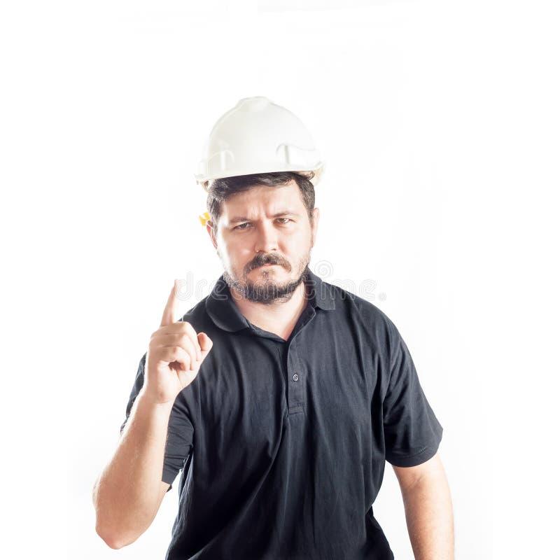 El retrato del ingeniero 30 años con el casco y el ojo blancos de la construcción de la seguridad protege los vidrios Primer conc imagen de archivo