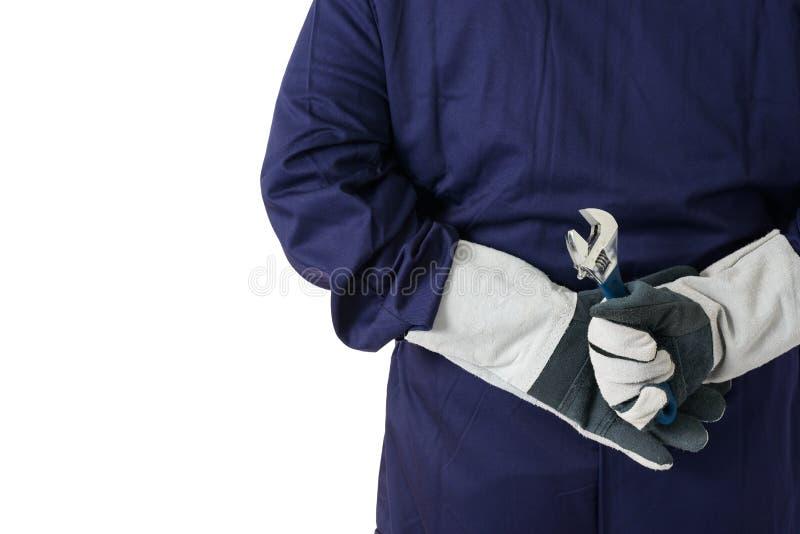 El retrato trasero de la visión de un trabajador en el mecánico Jumpsuit se está sosteniendo imagenes de archivo