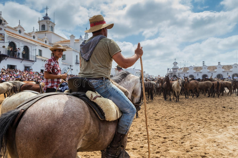 El ROCIO, ANDALUCIA, SPAIN - 26 JUNE 2016 Family Spanish equestrians, horses, guides for baptism. stock photo