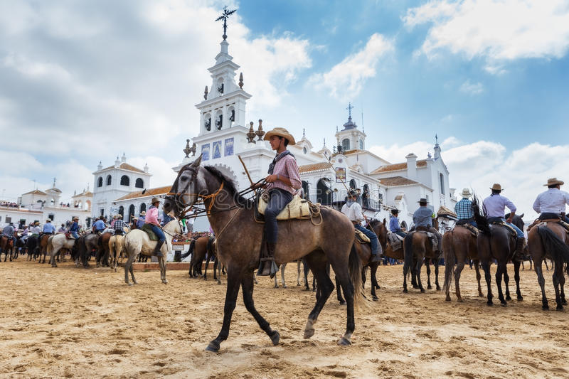 El ROCIO, ANDALUCIA, SPAIN - 26 JUNE 2016: Young boy rider guides horse to be baptized. stock image