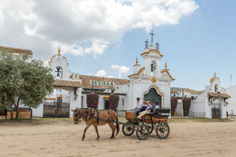 El Rocio, Spain-May 22, 2015 Spanish children ride on a cart with a horse near church. El Rocio, Spain-May 22, 2015 Spanish children ride on a cart with a horse stock images