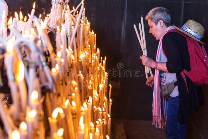El Rocio, Spain-May 22, 2015 Women light candles at festival of Romeria. El Rocio. Spain royalty free stock images
