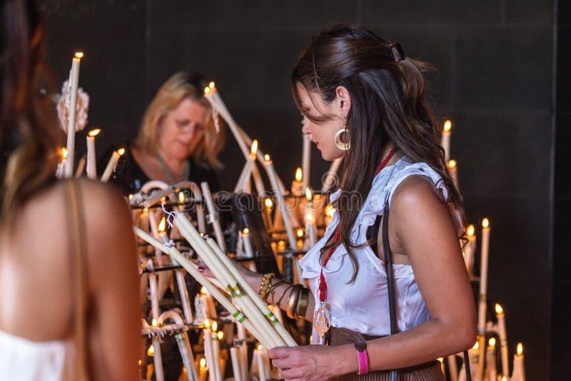 El Rocio, Spain-May 22, 2015 Women light candles at festival of Romeria. El Rocio. Spain stock photo