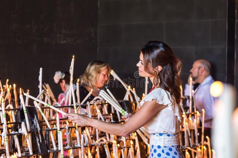 El Rocio, Spain-May 22, 2015 Women light candles at festival of Romeria. El Rocio. Spain royalty free stock photos