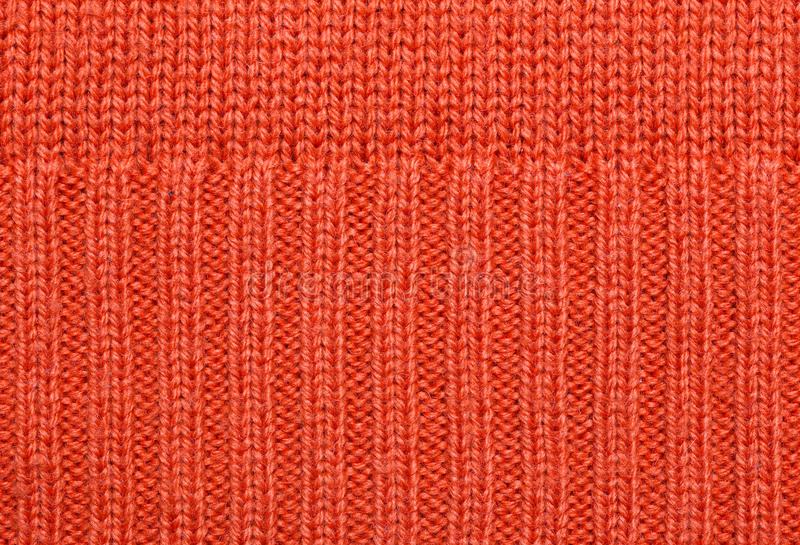 El rojo hizo punto textura de la tela imagen de archivo