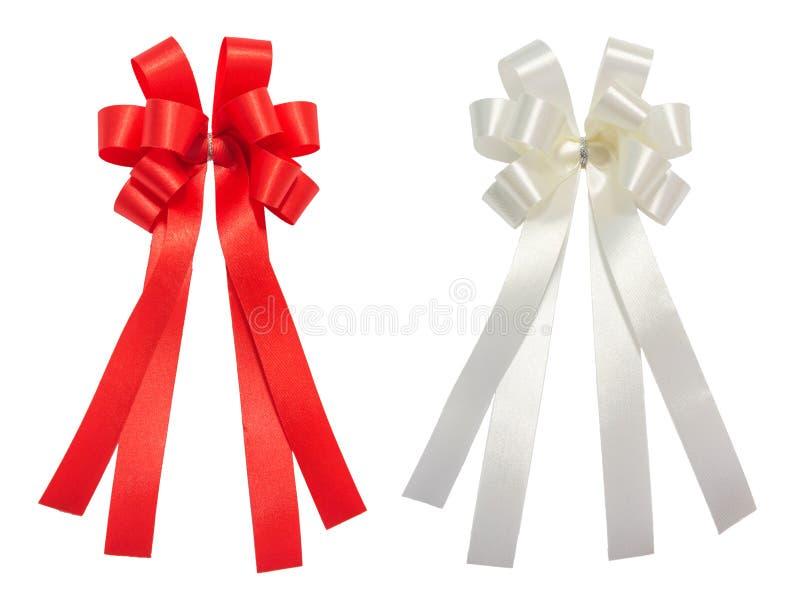 El rojo y el blanco arquean la cinta brillante del cuento, la Navidad, recompensa, premio, imagen de archivo libre de regalías