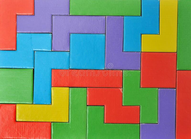 El rompecabezas colorido junta las piezas del fondo imágenes de archivo libres de regalías