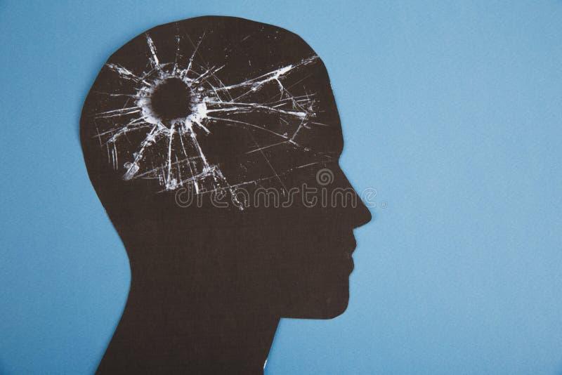 El símbolo del desorden del cerebro presentado por la cabeza humana hizo el papel de la forma Idea creativa para la enfermedad de imágenes de archivo libres de regalías