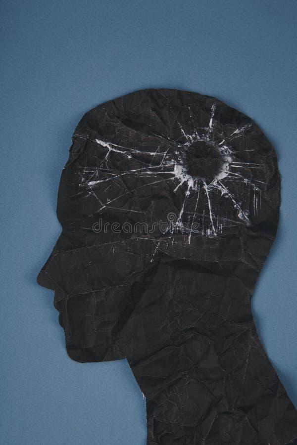 El símbolo del desorden del cerebro presentado por la cabeza humana hizo el papel de la forma Idea creativa para la enfermedad de fotografía de archivo libre de regalías