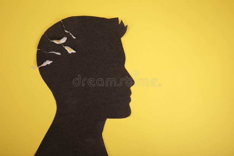 El símbolo del desorden del cerebro presentado por la cabeza humana hizo el papel de la forma Idea creativa para la enfermedad de imagen de archivo libre de regalías