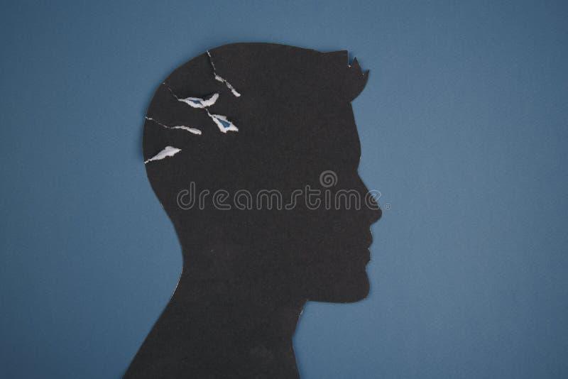 El símbolo del desorden del cerebro presentado por la cabeza humana hizo el papel de la forma Idea creativa para la enfermedad de fotos de archivo libres de regalías