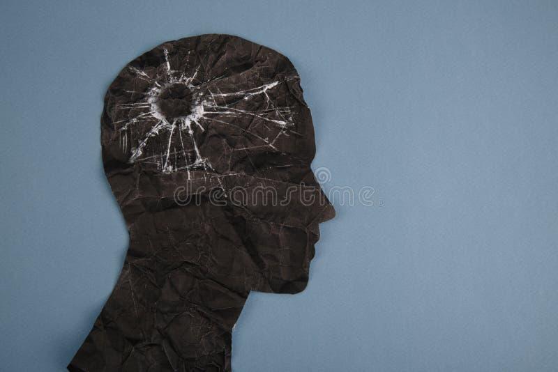 El símbolo del desorden del cerebro presentado por la cabeza humana hizo el papel de la forma Idea creativa para la enfermedad de fotografía de archivo